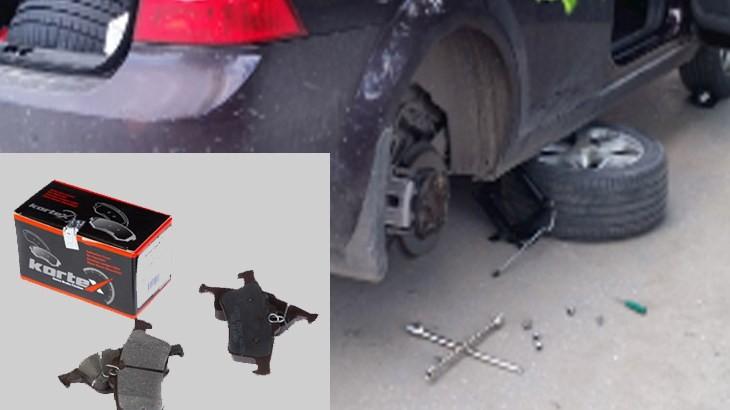 Поддомкраченный автомобиль со снятым колесом